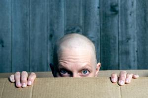 woman peeking out of box