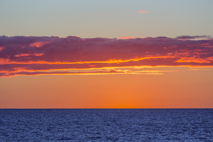 sunset over the blue waters of Northumberland Strait, Prince Edward Island, Canada
